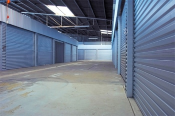 Inside the Ezi Storage Warehouse showing the outside of unit roller doors