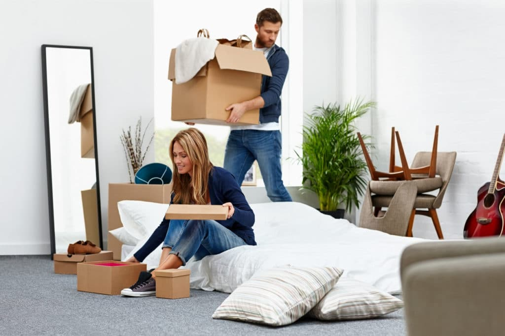 younge couple packing up home to move in together